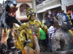 A man with his body painted attends Carnival celebrations in Jacmel, Haiti, Sunday, February 23, 2014. The city of Jacmel is known for its arts to kick off Haiti's pre-Lent festival. (Photo by Dieu Nalio Chery/AP Photo)