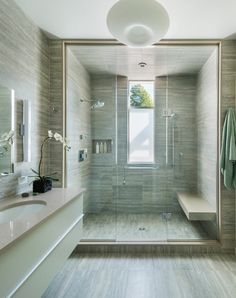 Even your glass shower door can improve the appearances of your bathroom instantly. You could use colorful glass shower doors or stained glass shower doors with numerous styles on stained glass. Modern Master Bathroom, Family Bathroom, Small Bathroom, Bathroom Showers, Bathroom Ideas, Parisian Bathroom, Tile Showers, Rental Bathroom, Bathroom Canvas