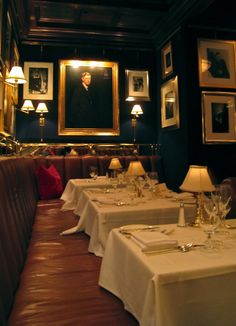 My favorite type of restaurant dining room. Dark walls, banquettes and table lamps
