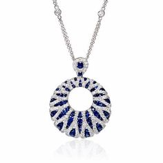 This exceptional 18k white gold pendant, features 93 round cut blue sapphires, of exquisite color, weighing 1.63 carats with 237 round brilliant cut white diamonds of F color, VS2 clarity, of excellent cut and brilliance, weighing 1.26 carats total.