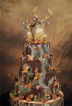 Shelby and Preston's camo wedding cake...............I'm going to assume that who ever made this cake does not know the difference between a buck and a doe....lol