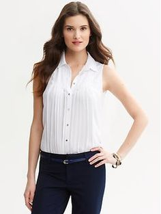 White sleeveless pleated blouse   Banana Republic. A good basic white shirt. Not too tight, not too loose.