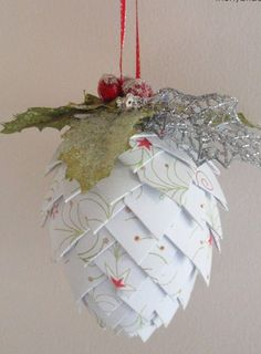Paper Pinecone Ornament {via The Hybrid Chick} - This looks like a fun craft to make your own homemade ornament. It is made with scrapbooking paper and a Styrofoam egg  and some little pretties on top.