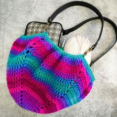 Twilight Stripes Fat Bottom Bag | Make a gorgeous hobo bag by making one large granny square - give it a shot!