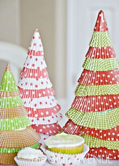 Cupcake liner Christmas Trees. This is so cute. Use a piece of cardstock and tape it into a cone shape. Trim the bottom so that it will stand up flat. Cut the centers out of cupcake liners and glue the ruffles on till everything is covered. Use a piece of the center to cover the tip and glue on the last ruffle.