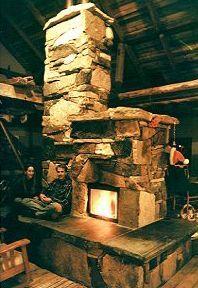 plaster and stone Masonry heater | stone mass heater more stones mass mass heater rocket mass