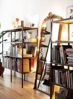 metal bookshelves + wall mirror