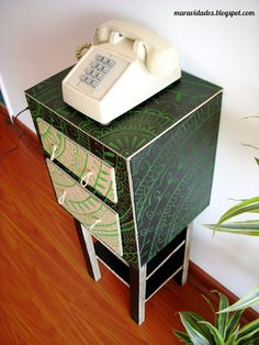 Yet another cardboard bedside table -henna drawings too.