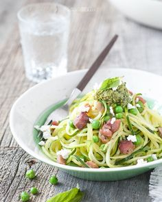 More green food! Link in profile for this Spiralized Pesto Pancetta and Pea Pasta with @kitehillcheese almond ricotta. I'll probably use some pesto in scrambled eggs for the morning too.  #stpatricksday #againstallgrain #grainfree  http://againstallgrain.com/2015/07/27/spiralized-zucchini-pesto-pasta/ by againstallgrain