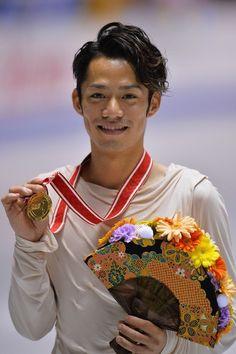 TOKYO, JAPAN - NOVEMBER 09:  Gold medalist Daisuke Takahashi of Japan poses on the podium during day two of ISU Grand Prix of Figure Skating...