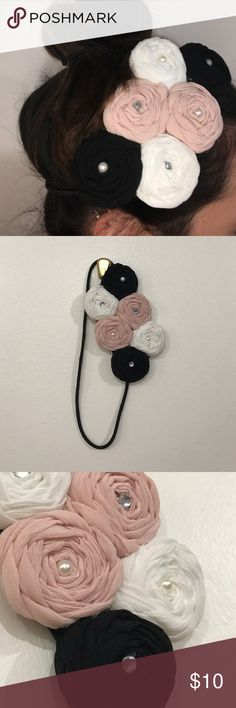 Icing by Claire's Elastic Floral Headband Pink, white, and black rosette flower headband. Pearl and rhinestone accents. Elastic wrap headband. Worn once. Claire's Accessories Hair Accessories