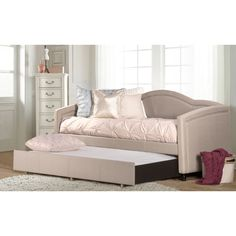 Save space in your bedroom with this Jasmine daybed and matching trundle bed. Stash the trundle underneath during the day for added floor space, and pull it out when it's time to go to bed. This versa