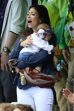 Michael Phelps' fiancee Nicole Johnson holding their son Boomer Phelps cheers for him during his race on day 6 of the Rio 2016 Olympic Games at. Olympic Swimmers, Olympic Athletes, Olympic Gymnastics, Olympic Games, Rio Olympics 2016, Summer Olympics, Nicole Johnson, Shawn Johnson, Boomer Phelps