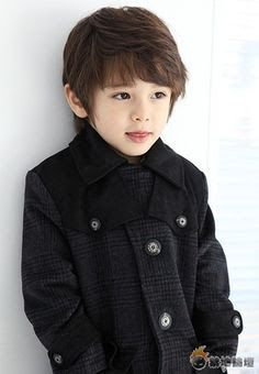 Doesn't he look like a character from some Japanese manga (cartoon strip)?  He does to me.  Love the stylish coat too!