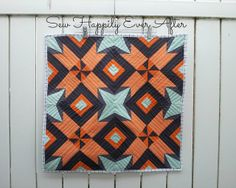 """Delightful """"Marine's Star"""" mini-quilt by Rachel Booth of Sew Happily Ever After. Great colors!"""