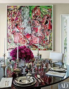 """The white float frame surrounding this colorful work of contemporary art offers just the right touch of visual relief in this stunning dining room. Float frames are a fabulous option when framing stretched canvases - not only to they act as """"jewelry"""" for the piece, the provide protection to the sides of the piece and will keep it looking perfect for years to come!"""