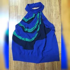Royal Blue Blouse with Green & Black Ruffles Features: halter style, 3-buttons in back of neck and open back..inside lining of blouse is torn but you can not tell from the outside...priced accordingly Tops Blouses