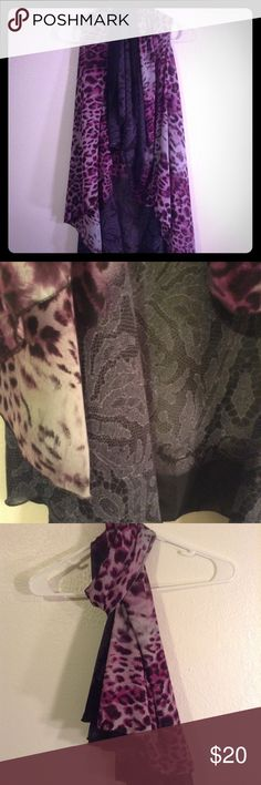 Multi-use Cover Up This thing is so much fun. It can be worn multiple ways, scarf, shawl, blouse etc. It does have arm holes, so the couple times I wore it over a solid black top. It is black and a magenta purple color. 100% polyester. Accessories Scarves & Wraps