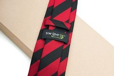 "SwipeTie - so cool, they have a microfiber lining to ""swipe"" your iphone with"