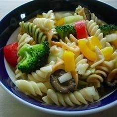Use colorful corkscrew pasta to make a festive cold salad packed full of fresh tomatoes, bell peppers, onions, cucumbers, broccoli and mushrooms. Toss with your favorite Italian-style salad dressing and chill to let the flavors blossom before serving.