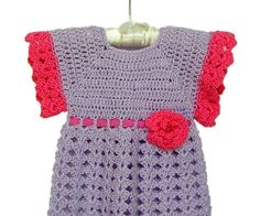 Lilac Baby Dress Crochet Dress Lilac and Raspberry by knitwhats This pretty little baby dress is a beautiful shade of lilac trimmed with raspberry pink, crochet with the softest baby yarn, this dress is delicate and dainty.   Adjustable matching raspberry pink crinkle ribbon weaves through the waistline of the dress with a raspberry flower on the waist. The bottom hem has a raspberry petticoat trim which just peeks out! Two matching lavender buttons close the upper back of the dress.  I…