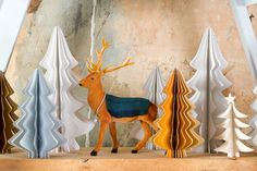 Skandi / alpine table decorations. Stags with tartan detail & paper Christmas trees.