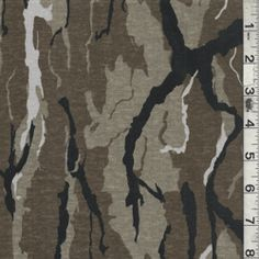 """Taupe/Black Camo Jersey Knit  Item#: 15726      Taupe, Black & Cocoa  Forest Phantom Camouflage Jersey Knit Fabric  Suitable for Apparel  100% Cotton  60"""" wide  Machine Washable  5.95 per yard"""