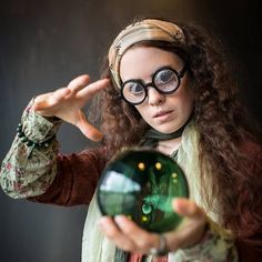 Use a boho outfit and bottle glasses to dress as Trelawney from Harry Potter.