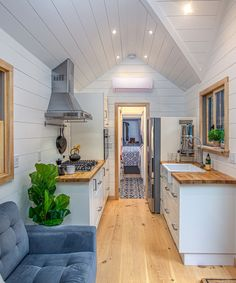 Burmenbov by Willowbee Tiny Homes - Tiny Living The large galley kitchen includes white cabinets with butcher block counters, a white apron sink, a separate cooktop and oven, a refrigerator with bottom freezer, and a large amount of storage space. Home, Tiny Spaces, House Design, Tiny House Living, Small Kitchen, Small Living, Camper Interior Design, Little Houses, House Interior
