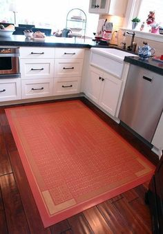 One of the biggest complaints, and hardest things to change, about a rental kitchen is the floor. When you own a kitchen you can put down new tile or wood floors — but even then you may not want to for reasons of cost. So, many of us are stuck with ugly, peeling linoleum tile, but here's one great option for renters and budget owners alike: Canvas floor cloths.
