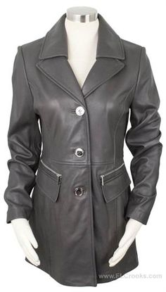 This beautiful car coat from Kenneth Cole New York has a hint of a modern touch with shiny silver zippers above the pockets. Large shiny buttons adorn the front to complete this car length coat made of 100% soft leather. Fully lined.  Women's Kenneth Cole New York Button Front Leather Car Coat Charcoal Grey  #kennethcole #kennethcolenewyork #carcoat #leathercoat