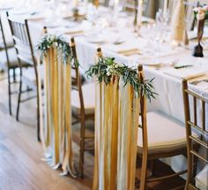 Ribbon and foliage garland mark the bride and groom chairs | Winter Wedding by Jessica Sloane and Tec Petaja