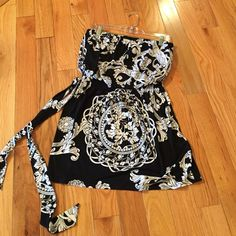 Black and white strapless top Black and white strapless top with tie belt. White House Black Market Tops Tunics