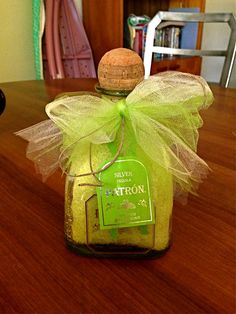DIY Gift. Epsom salt with preferred oils mixed with a splash of food coloring. Add to an interesting bottle and finish it with a bow! Super easy gift idea. Relaxation in a bottle. Add to a warm bath :) #DIY #Gifts #BathScrubs #BathSalts #Patron #Bottles #UniqueGifts