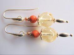 Oorbellen Sifra heldere citrien met swarovski parels in Coral en peach tint. met druppel oorhaak. geheel zilver.