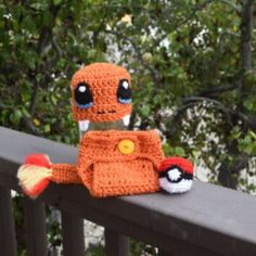 New listing up in my shop! Crochet Charmander pokemon set includes hat, diaper cover, and pokeball.