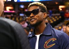 Usher Photos Photos - Recording artist Usher attends Game 3 of the 2017 NBA Finals between the Golden State Warriors and the Cleveland Cavaliers at Quicken Loans Arena on June 7, 2017 in Cleveland, Ohio. NOTE TO USER: User expressly acknowledges and agrees that, by downloading and or using this photograph, User is consenting to the terms and conditions of the Getty Images License Agreement. - 2017 NBA Finals - Game Three