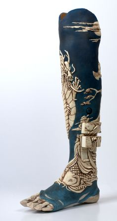 Oriental leg photographed by Annie Walters - an artificial leg with secret drawers