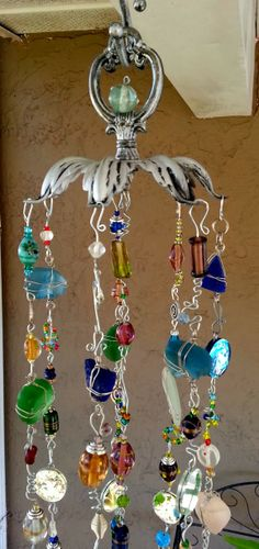 Reflections Windchime/Suncatcher not sure exactly what is being used for the top love the look of a finial Wire Crafts, Bead Crafts, Diy And Crafts, Arts And Crafts, Mobiles, Blowin' In The Wind, Diy Wind Chimes, Hanging Art, Window Hanging