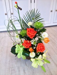 Corporate flowers spring arrangement in green and orange flowers by Atelier Floristic Aleksandra concept Alexandra Crisan