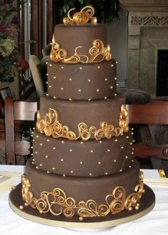 Chocolate wedding cake with gold beading and scrollwork.  Gorgeous!   ᘡղbᘠ