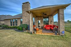 27003 Franklin Park Dr. Spacious back patio sides to the open green area running beside  this exceptional home. Bernstein Realty, Houston Real Estate