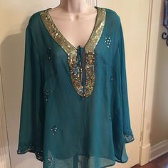 Embellished blouse The pics explain themselves. Wear poolside as a cover up! Bling Bling!!!! ❤️ I would consider this one size fits all. Turquoise color. Swim Coverups