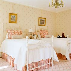 Pink for Two, Please - A mini social butterfly would be right at home in this room fit for entertaining. A set of iron twin beds allows for sleepovers. A refurbished, Victorian-look antique nightstand was chosen for its size and subtlety, appearing dainty against the softly patterned wallpaper.