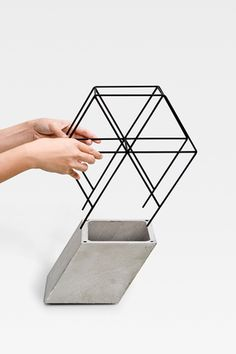 Thinkk Studio. concrete, wood, contrast, minimalist, simple, truss vases