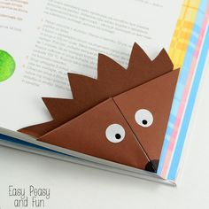 "Hedgehog Corner Bookmark - Origami for Kids crafts are usually ""reserved"" for fall but I do love this animal so much I just had to make this hedgehog corner bookmark. These origami corner bookmarks are a great beginner"