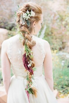 braided hair with flowers - photo by D'Arcy Benincosa Photography http://ruffledblog.com/an-incredible-handcrafted-wedding-in-salt-lake-city