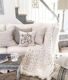 The ArtizenHome Large Chunky Knit Throw is just the right size for cuddling up on a rainy (or snowy) day with a book. Especially if you really aren't into the b #Minimalistlivingrooms