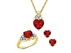 Heart-cut Rubies Set. Perfect for Valentine's Day @ $49.00. Created Rubies set in 14K Gold over Sterling Silver. Set includes ring (size 7) earrings and pendant with chain.