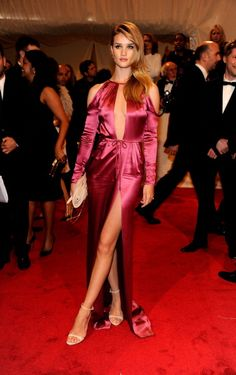 On the red carpet at the 'Alexander McQueen: Savage Beauty' Costume Institute Gala at The Metropolitan Museum of Art in New York in 2011. See all of Rosie Huntington-Whiteley's best looks.